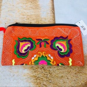 Embroidered fabric wristlet -